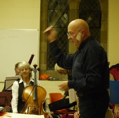 John conducting the orchestra